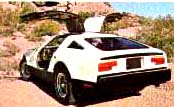 white Bricklin with open gull-wing doors