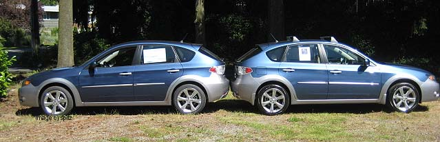 back-to-back Outback Sports-on left 2011 Marine Blue Pearl, on right