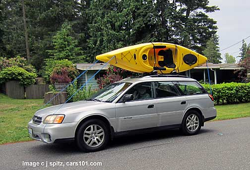 2004 silver subaru outback with 2 kayaks on the roof rack