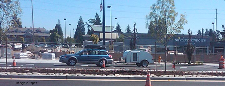 subaru outback towing a small trailer