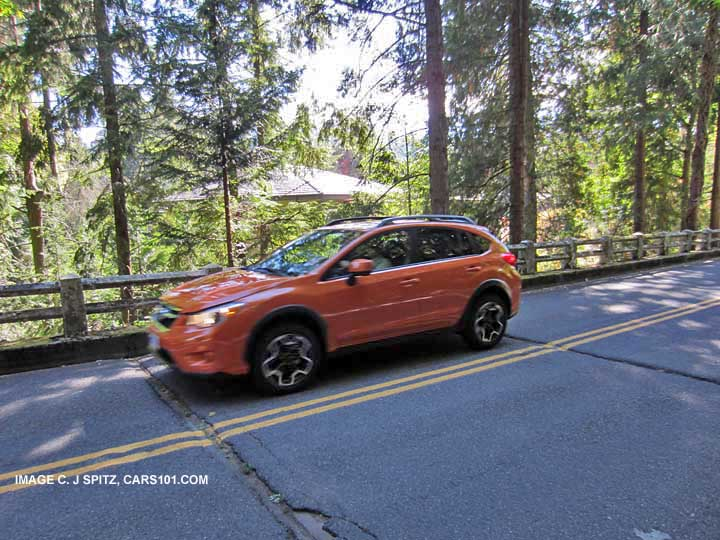 Subaru Xv Crosstrek On A Winding Road Tangerine Orange