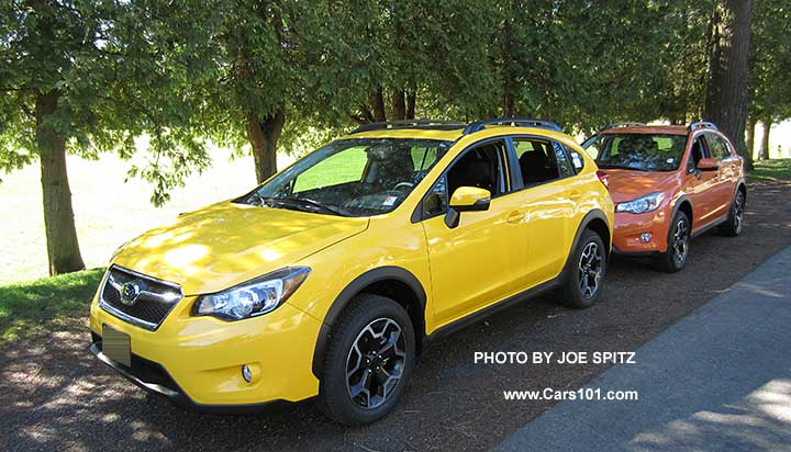 2017 Subaru Sunrise Yellow Crosstrek Premium Special Edition Next To A Tangerine Orange