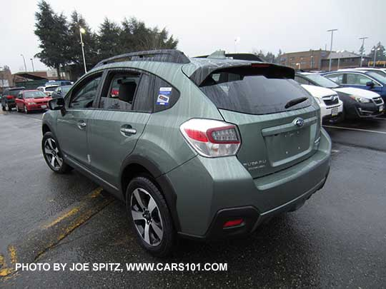 new and side view subaru crosstrek hybrid touring in the rain jasmine green color without. Black Bedroom Furniture Sets. Home Design Ideas