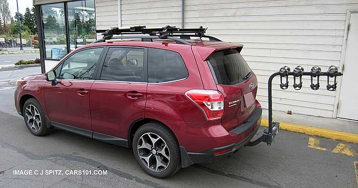 Subaru Forester With Aftermarket Hitch Mounted 4 Bike Carrier And Crossbars