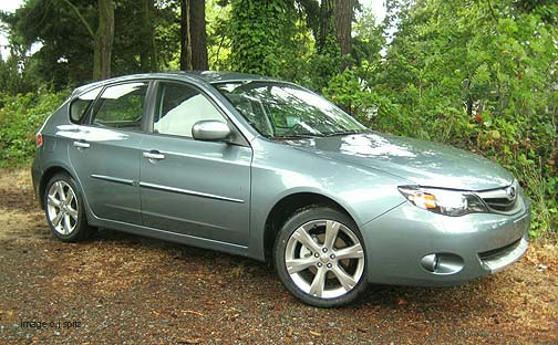 new for 2011 one color sage green Outback Sport, shown without the standard roof racks installed