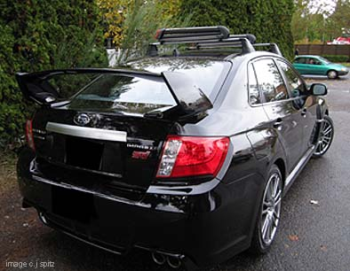 2011 Subaru STI 4 Door Sedan With Optional Roof Rack And Ski Attachment