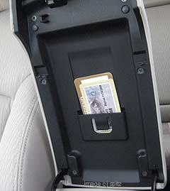 2010 legacy armrest storage slot for parking passes, tickets etc