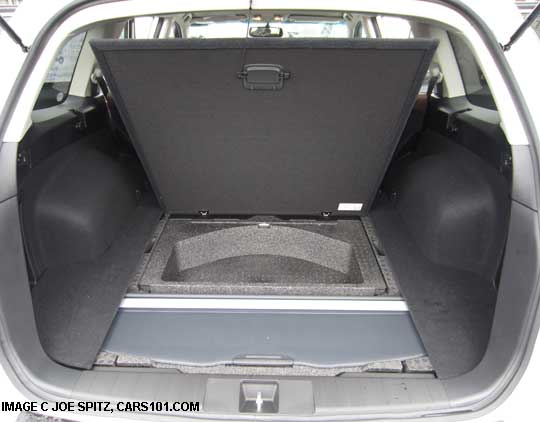 subaru outback cargo luagge area coiver shown stowed under the cargo