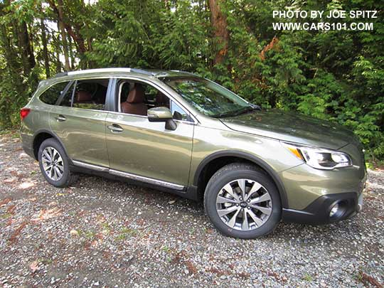 Side View 2017 Subaru Outback Touring Wilderness Green Shown Silver Low Profile Roof Rails
